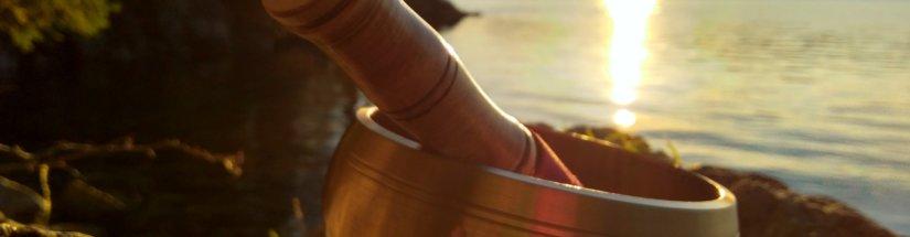 Singing bowl in sunset